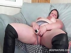 Big boobed mature vibrating cunt