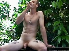 Gay stud eats fruit naked