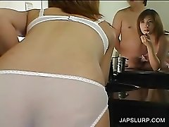 Japanese in lingerie licks a horny dick