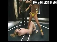 Lesbians wrestle for the strapon prize