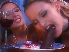 Two aroused lesbians in sexy lingerie having fun with sex toys