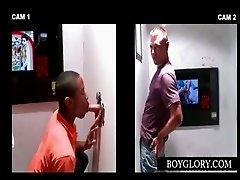 Gloryhole scene with couple giving blowjob