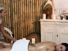 Taooed brunette gets oil massage