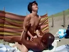 My horny wife having fun with a black stranger at beach