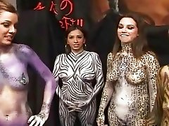Bodypainted girls having wild sex with hung dude