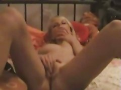 Blondie plays with her wet pussy
