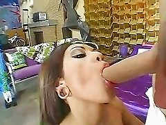 Busty brunette Adrenalynn deepthroating a meaty hard dick