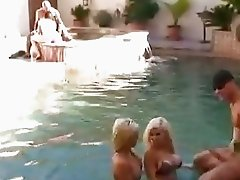 Esperanza Gomez shares a thick rod in the pool with Halia Hill