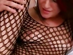 Latina babe wearing a bodystocking gives a blowjob in the bedroom