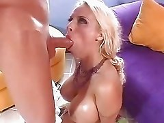 Blonde pornstar with enormous knockers does blowjob on her knees