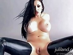 Dark haired bitch in black latex with gloves masturbating
