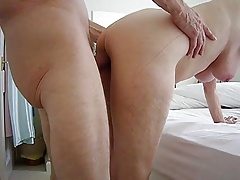 Fucking my wife standing doggy.