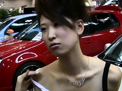 Sexy slender Japanese model flashes her cleavage in public