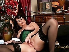 Tight green corset and stockings on a milf goddess
