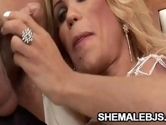 Grazielle - Busty Mature Shemale Sucking A Big Cock