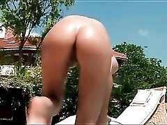 Teen girl gets all wet and bottle fucks in the pool