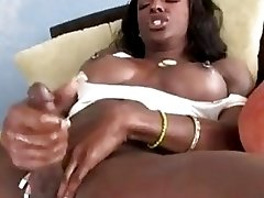 Exquisite black tranny polishes her huge prick by the mirror