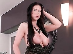 Photographer fondles big titties of his model