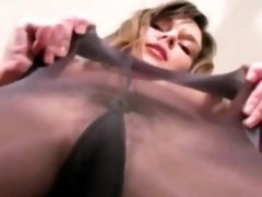 Super sexy vixen widens legs in pantyhose to expose slit
