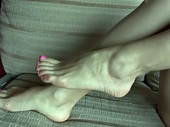 Hot babe with shaved pussy spreads her long legs
