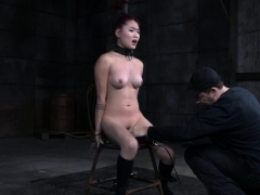 Asian redhead gets bound and toyed with