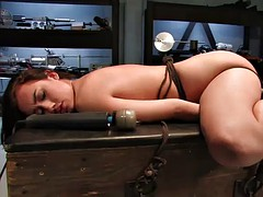 horny brunette is tied up and fucked by a machine