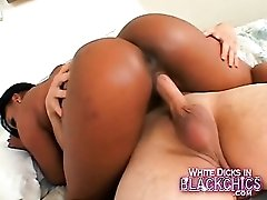 Curvy black girl rides his white cock hard