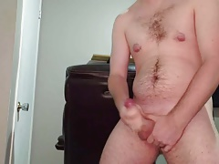 Messy cumshot from jerking my uncut cock