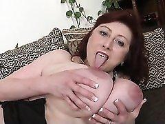 Solo mature model fondles her huge tits