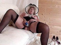 Classy grandma in black lingerie masturbates