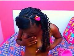 Cute Ebony Girl Licking Her Tits