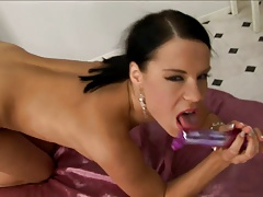 Slutty Alex moans with pleasure as she fucks her pussy with a purple vibrator