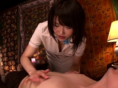 Big breasted Japanese bombshell sits on top of a hard prick