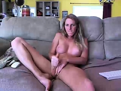 Sexy webcam shemale with big tits jerks off on the couch