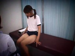 Pretty Oriental teen has a doctor thoroughly examining her