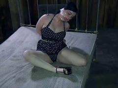 Bondage whore left on a dirty bed to suffer BDSM