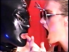 a male rubber slave has to do what his mistress orders.mp4
