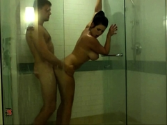 Big breasted milf gets drilled from behind in the shower
