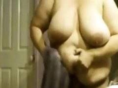 Large Woman Showering And Drying Off