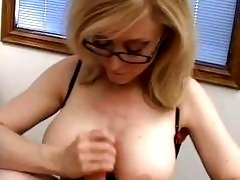 Nerdy blonde momma with glasses sucking meaty knob