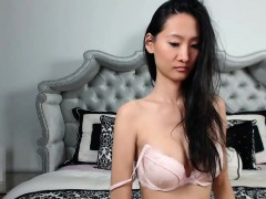 Long-haired Asian babe wears white lingerie to flaunt her h