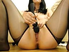 cute brunette in stockings rides dildo feeling pleasure