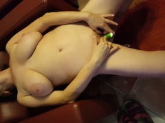 Big breasted cougar has her fingers and a sex toy satisfyin
