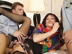 Three men fuck a housewife in bed