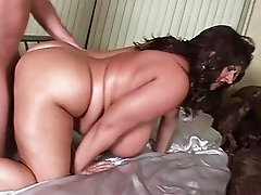 Lusty mega breasted MILF babe blows a fat piece of meat