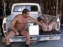 A man is pounding his friends ass with a big dildo