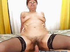 mature short hair granny in black pantyhose having sex